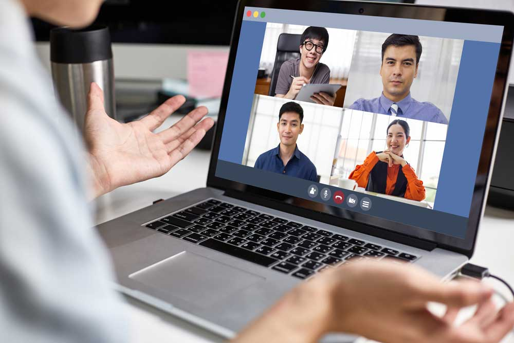 A man talking to his colleagues in an online meeting similar to Microsoft Teams