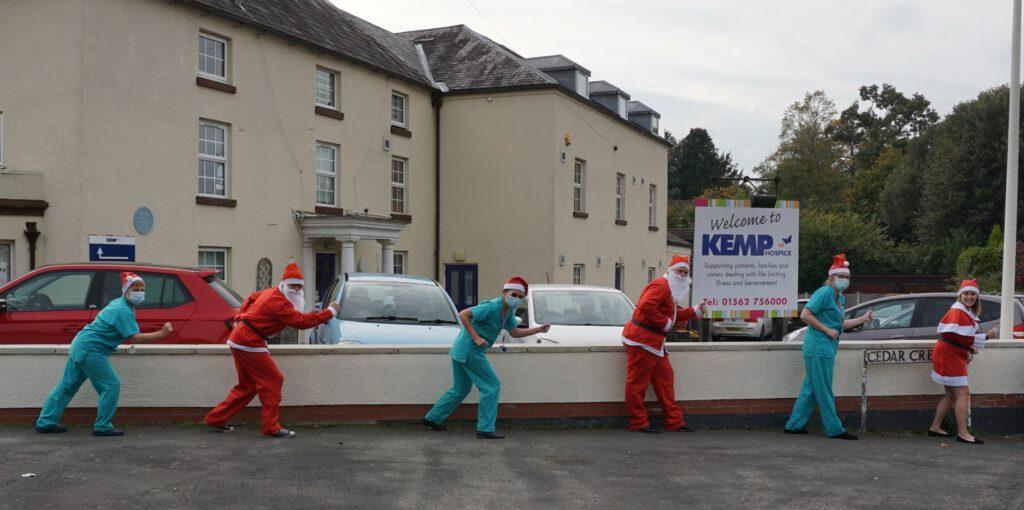 Blisstech Solutions, - Wyre Business Consultants & KEMP nurses pretending to run dressed as Santa