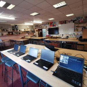 Laptops being prepared in a classroom at Lacon Childe School